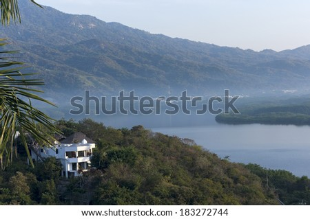 Santiago Bay and Sierra Madre mountains of Manzanillo Mexico at sunrise - stock photo