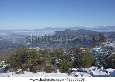 Santiago, capital city of Chile, viewed from Cerro Pochoco. - stock photo