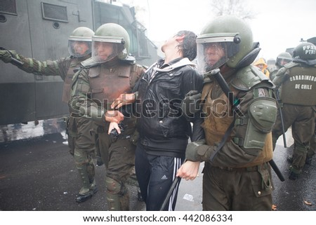 Santiago, Chile - April 11, 2013: Chilean protestors clash with Chilean Carabineros in riot gear during a protest for education equality.