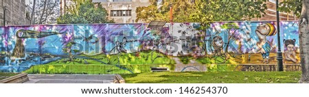 SANTIAGO, CHILE - FEBRUARY 15: Colorful graffiti on a walll in a central avenue on February 15, 2011 in Santiago, Chile. 5.5 million population in Santiago de Chile. - stock photo