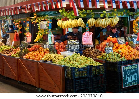 SANTIAGO, CHILE - JULY 8, 2014: Fresh fruit and vegetables for sale in the historic Mercado Central in Santiago, capital of Chile    - stock photo