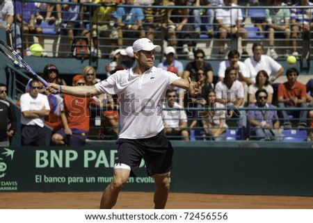 SANTIAGO, CHILE - MAR 4: Andy Roddick from USA uses his forehand in the match against  Nicolas Massu from Chile during the first match valid for the Davis Cup. March 4, 2011 in Santiago Chile.