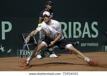 SANTIAGO, CHILE - MAR 4: Andy Roddick from USA uses his forehand in the match against  Nicolas Massu from Chile during the first match valid for the Davis Cup. March 4, 2011 in Santiago Chile. - stock photo