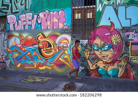SANTIAGO, CHILE - MARCH 17, 2014: Brightly colored murals in Barrio Bellavista, Santiago, Chile. This neighborhood is renowned for its street art and for its many cafes, restaurants and bars.