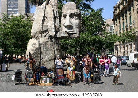 SANTIAGO, CHILE-NOV.2:  Mapuche Indians, an ethnic minority in Chile comprising less than 4% of the population, perform native music at Plaza de Armas on November 2, 2012 in Santiago, Chile. - stock photo
