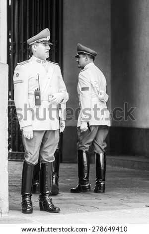 SANTIAGO, CHILE - NOV 1, 2014:  Unidentified Chilean guardians in Santiago. Chilean people are mainly of mixed Spanish and Amerindian descent