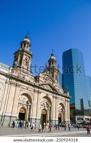 SANTIAGO DE CHILE, CHILE - MARCH 17, 2008: Metropolitan Cathedral and people on the Plaza de Armas in the center of Santiago de Chile. - stock photo