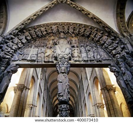SANTIAGO DE COMPOSTELA, SPAIN - APRIL 14, 2000: Portico de la Gloria - The main entrance gate to the cathedral in Santiago de Compostela, Galicia. Camino de Santiago is World Heritage Site by UNESCO - stock photo