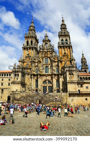 SANTIAGO DE COMPOSTELA, SPAIN - AUGUST 14, 2010: Pilgrims at my destination before the cathedral in Santiago de Compostela, Galicia. Camino de Santiago is World Heritage Site by UNESCO - stock photo