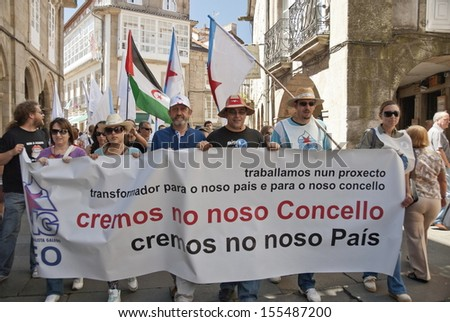 SANTIAGO DE COMPOSTELA, SPAIN - JULY 25: Unidentified Galicians take part in a demonstration with requirements of granting of independence from Spain on July 25, 2010, Santiago de Compostela, Spain.