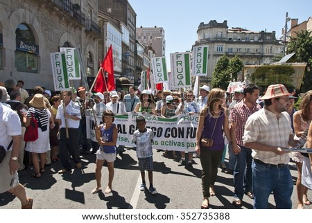 SANTIAGO DE COMPOSTELA, SPAIN - JULY 25: Unidentified Galicians take part in a demonstration with requirements of granting of independence from Spain on July 25, 2010, Santiago de Compostela, Spain. - stock photo