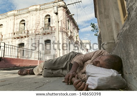 SANTIAGO DE CUBA, CUBA - APRIL 10, 2009: Homeless rests in the street in Santiago de Cuba on April 10, 2009. Poor Cubans flock to the streets of Santiago in search of a bed and a piece of bread.