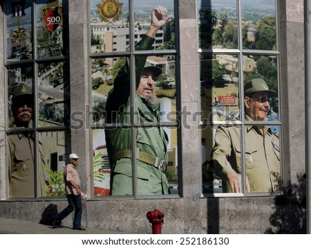 SANTIAGO DE CUBA, CUBA - NOVEMBER 29: Portrait of Fidel Castro and his brother Raul in the center of the town, on november 29, 2014, in Santiago de Cuba, Cuba. - stock photo