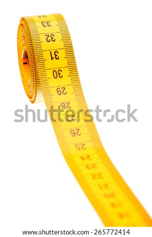 Santimert for measurement of the sizes and volumes of yellow color on a white background, nobody. - stock photo
