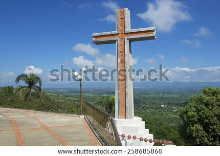 SANTO CERRO, DOMINICAN REPUBLIC - NOVEMBER 05, 2012: Modern cross overlooking the valley of Cibao on November 05, 2012 in Santo Cerro, Dominican Republic.