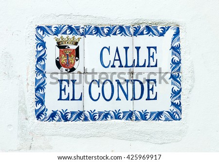 SANTO DOMINGO, DOMINICAN REPUBLIC - MARCH 11  Close up of El Conde street sign, this is the main pathway of the Colonial Zone Historical District on March 11, 2011 in Sto Domingo, Dominican Republic.
