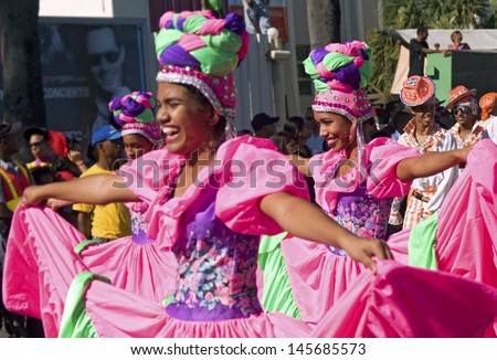 "SANTO DOMINGO, DOMINICAN REPUBLIC - MARCH 6: Dancers parading at ""Malecon"" Carnival on March 6, 2011 in Santo Domingo, Dominican Republic. Exotic customs are important part of  this free annual event."