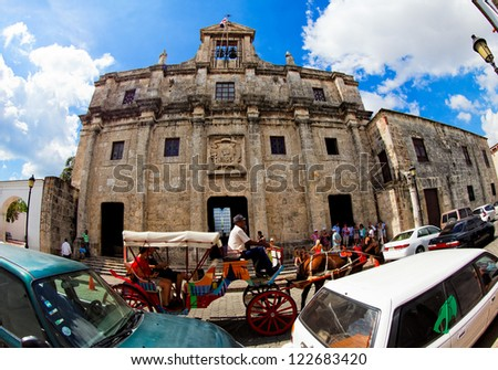 SANTO DOMINGO - NOV 9: Views of the National Pantheon with Dame Street on November 9, 2012 in Santo Domingo. Dominican Republic. Calle Las Damas the oldest and best-preserved old town street. - stock photo