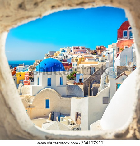 Santorini blue dome church look through the chimney, Greece - stock photo