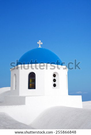 Santorini Blue dome church with blue sky. Oia Village, Greece. - stock photo