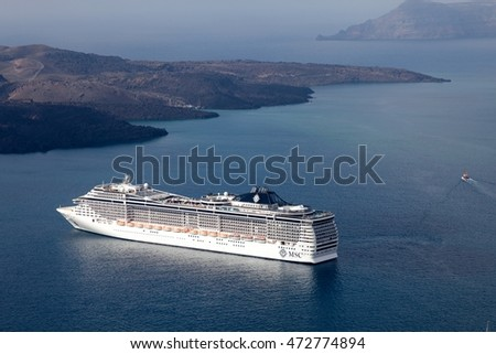 SANTORINI, GREECE-AUGUST 20: MSC Fantasia cruise ship near Santorini island in Aegean sea. MSC Fantasia is the largest cruise ship ever built for a European ship owner. It has 1637 staterooms.