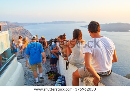 SANTORINI, GREECE - AUGUST 07, 2015: people meet sunset on Santorini island. Santorini, classically Thera, and officially Thira, is an island in the southern Aegean Sea