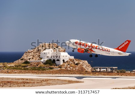 SANTORINI, GREECE - July 10, 2011: easy jet low cost airline, Airbus A320 aircraft departing from International Airport 'Santorini', Greece.