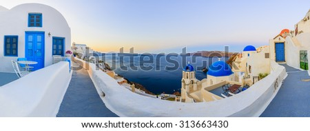 Santorini, Greece - Oia village at sunset, panorama - stock photo