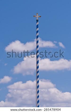 Santorini Greece Religious Pole, Cross, Sky and Clouds - stock photo