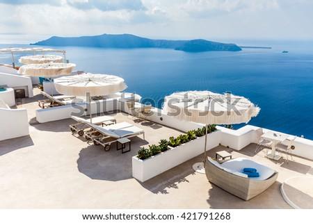 Santorini island, caldera view and sun beds, Greece - stock photo