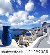 Santorini island with church and blue vase in Greece - stock photo