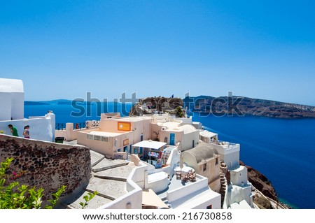 SANTORINI,OIA-JULY 28: Tourists on the Castle of Oia on July 28,2014 in Oia town on the Santorini island, Greece.