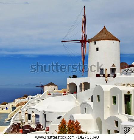 Santorini, Oia village. windmill-hotel - stock photo