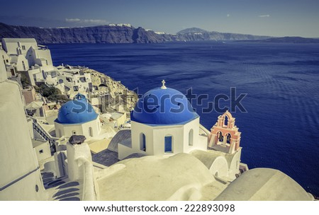 Santorini scene with famous blue dome churches, Greece
