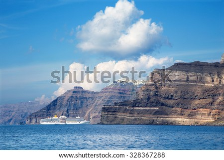 Santorini - The cliffs of calera with the cruises withe the Imerovigli and Skaros in the background. - stock photo