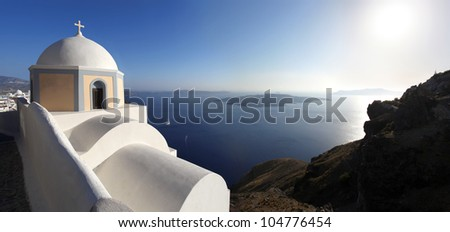 Santorini with Caldera view and white church in Greece
