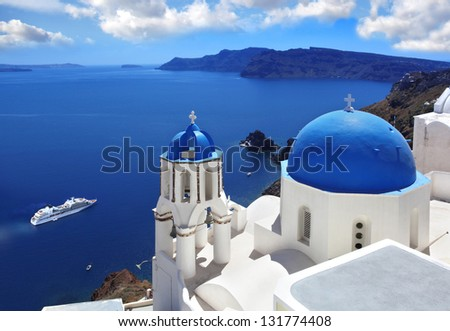 Santorini with churches and sea view in Greece - stock photo
