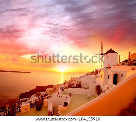 Santorini with famous windmill in Greece, Oia village - stock photo
