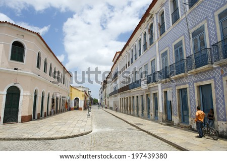 SAO LUIS, BRAZIL - OCTOBER 2, 2013: Man stands on the sidewalk of Rua Portugal, a street known for its traditional Portuguese colonial architecture. - stock photo