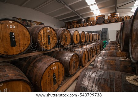 SAO MIGUEL ISLAND, AZORES, PORTUGAL - MAY 24, 2016: Storage of barrels of the Mulher do Capote liquor factory located in Sao Miguel island, Azores, Portugal.