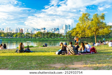 SAO PAULO, BRAZIL - CIRCA AUGUST 2014: People enjoy a hot day in Ibirapuera Park. Ibirapuera Park is the largest park in Sao Paulo, Brazil. - stock photo