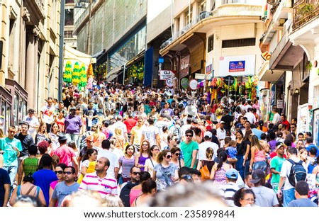 SAO PAULO, BRAZIL - CIRCA DEZ 2014: Hundreds of People walk along the 25 March area in Sao Paulo, Brazil. 25 March is a popular commerce region near the center of Sao Paulo, Brazil. - stock photo