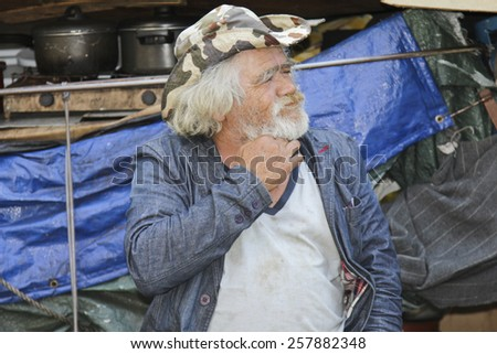 SAO PAULO, BRAZIL - FEBRUARY 08, 2015: An unidentified homeless with his house and things living at the famous Paulista Avenue in Sao Paulo Brazil. - stock photo