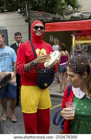 SAO PAULO, BRAZIL - JANUARY 31, 2015: An unidentified man dressed like a Chapulin Colorado participate in the annual Brazilian street carnival dancing and singing samba. - stock photo