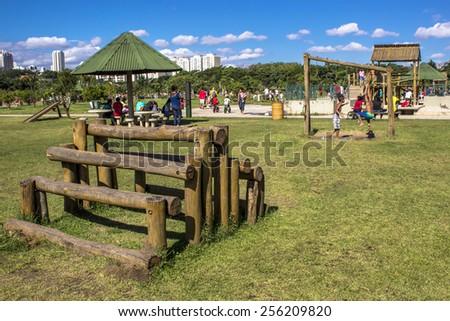 SAO PAULO , Brazil. January 20, 2012. People in Villa Lobos Park. The park is a good place for walkers, cycling and an oasis for the skaters. - stock photo