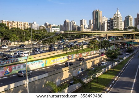 Sao Paulo, Brazil, January 05, 2016: Traffic on the famous 23 de Maio Avenue in Sao Paulo, Brazil. This avenue run past Ibirapuera Park. A graffiti art on the structure.