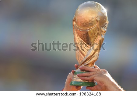 SAO PAULO, BRAZIL - June 12, 2014: A replica of the World Cup being showcased during the World Cup Group A opening game between Brazil and Croatia at Corinthians Arena. No Use in Brazil.  - stock photo