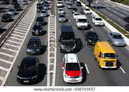 SAO PAULO, BRAZIL, JUNE 09, 2016: A traffic on the famous 23 de Maio Avenue in Sao Paulo, Brazil. This avenue run past Ibirapuera Park.