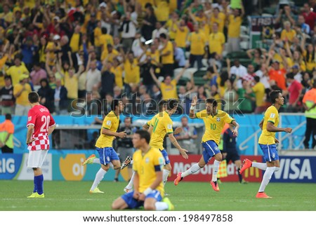 SAO PAULO, BRAZIL - June 12, 2014: Brazil team celebrating after winning the opening game against Croatia at Corinthians Arena. No Use in Brazil.