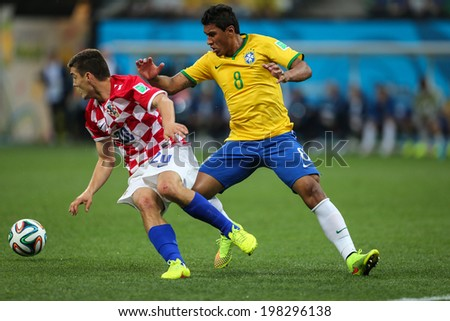 SAO PAULO, BRAZIL - June 12, 2014: Brazilian player competing for the ball during the World Cup Group A opening game between Brazil and Croatia at Corinthians Arena. No Use in Brazil.